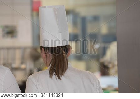 Female Chef Or Cook In Gastronomy Kitchen