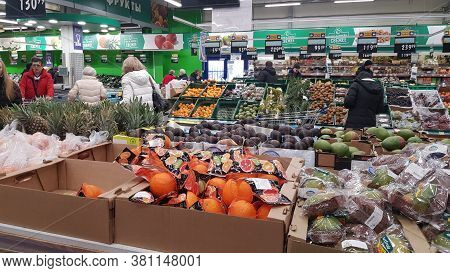 Russia, St. Petersburg 17,03,2020 People In The Vegetable Department Of The Supermarket In The Super