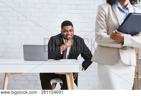 Sexual Molesting Concept. Perverted African American Businessman Ogling At His Female Subordinate In