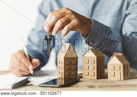 Considering Buying A Home, Investing In Real Estate. Broker Signs A Sales Agreement.