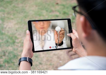 Close-up Of Videoconferencing With Male Doctor On Laptop At Desk,healthcare Concept