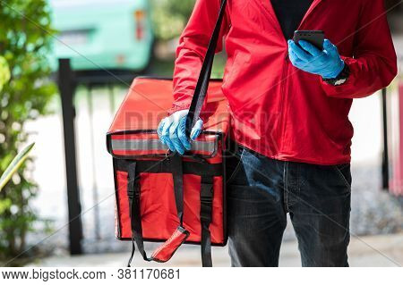Delivery Man Red Cloth Searching For Customer Address By Mobile Phone