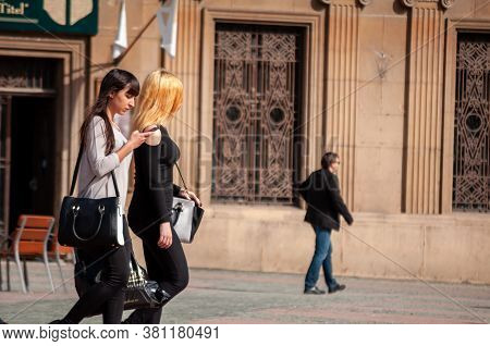 Timisoara, Romania - April 13, 2016: Woman Walking On The Street. Real People.