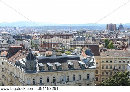 A View Of A Wien City With Large Buildings In The Background