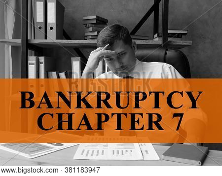 Bankruptcy Chapter 7 Concept. Sad Businessman In The Office.