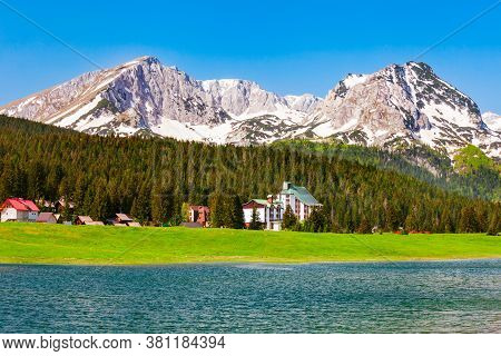 Black Lake Or Crno Jezero And Veliki Medjed Peak Mountain In Durmitor National Park In Montenegro
