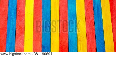 Colorful Ice Cream Stick. Red, Yellow And Blue Color. Abstract Wooden Sticks Background. Colorful Ra