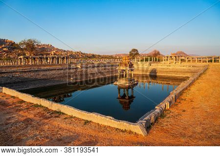 Temple And Water Tank At Hampi, The Centre Of The Hindu Vijayanagara Empire In Karnataka State In In