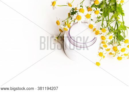 Plastic Bottle Of Essence Or Serum And With Chamomile Flowers