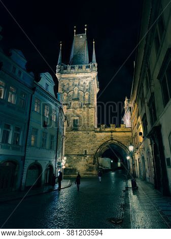 Czech Republic, Prague 11 March 2020: Prague, Smalltown Bridge Tower In The Night After Rain