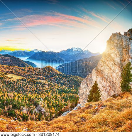 Autumn Landscape With Yellow Larches And Astonishing  Marmolada Mountain At  Sunset. Location: Falza