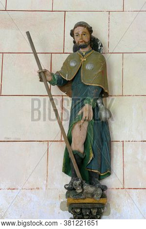 DESINIC, CROATIA - OCTOBER 18, 2013: Saint Roch, a statue in the chapel of Saint Anne in Desinic, Croatia