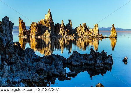 Picturesque Mono lake. California. Evening sunset. The columns - remains of