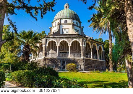 High shore of Lake Tiberias. Church of the Beatitudes. The church is octagonal in honor of the eight Beatitudes. Wonderful sunny day. The concept of religious pilgrimage, ethnographic tourism
