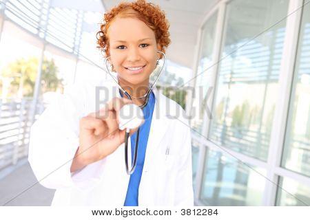 Pretty African Nurse At Hospital
