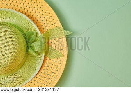 Summer Holidays. Headdress. Straw Hat. Beachwear. Seasonal Female Cap With Bow Isolated On Green Bac
