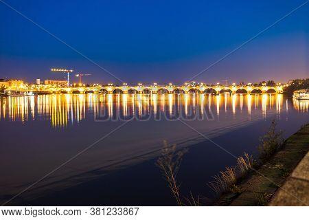 Pont De Pierre Bridge In Bordeaux At Night. Bordeaux Is A Port City On The Garonne River In Southwes