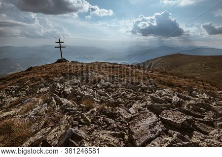 Patriarchal Cross On The Mountain Summit With Spectacular Sun Rays Through The Clouds. Low Tatras (n