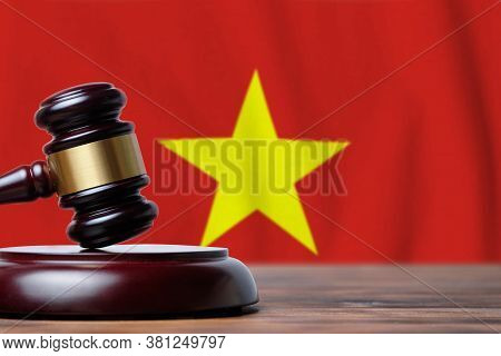 Justice And Court Concept In Socialist Republic Of Vietnam. Judge Hammer On A Flag Background.