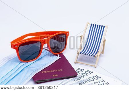 The Photo Shows Sunglasses, Passport, Deck Chair, Cash And A Protective Mask