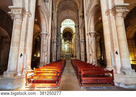 Coimbra, Portugal - June 29, 2014: Old Cathedral Of Coimbra Or Se Velha Is A Roman Catholic Church I