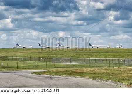 Horizontal Shot Of Passenger Jet Aircraft Lined Up Waiting On Takeoff Permission.