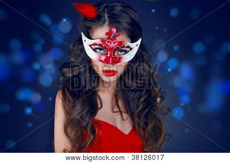Masquerade. Beautiful Girl In Carnival Mask Over Holiday Bokeh Glitter Background.