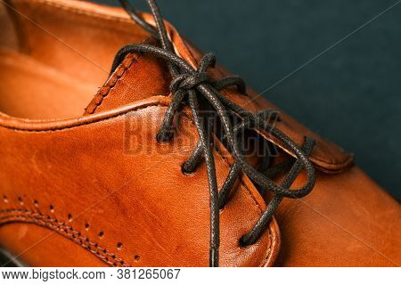 Part Of Mens Shoes Close-up. Focus On The Black Laces. Mens Shoes Made Of Genuine Leather. Brown Sho