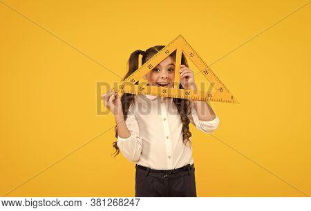 Knowledge Day. Schoolgirl School Uniform Hold Big Ruler Geometry School Lesson. Triangle Right Angle