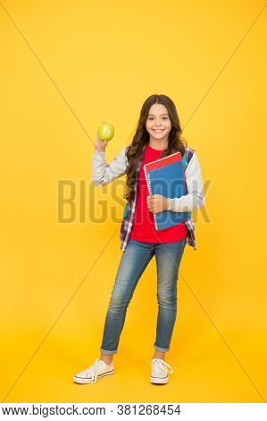 Healthy Snack. Happy Child Hold Apple And Books. School Snack. Snack Break. Healthy Eating And Snack