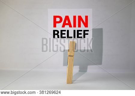 Pain Relief Card In Hands Of Medical Doctor, Concept