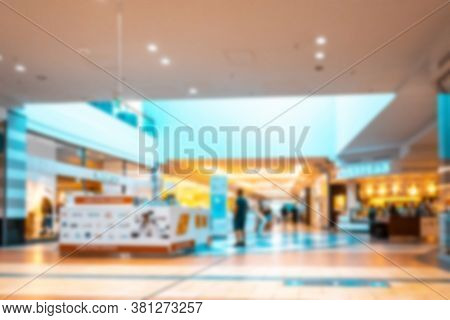 People Shop Window Blurred Background. Interior Of Retail Centre Store In Soft Focus. People Shoppin