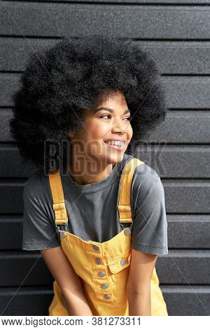 Happy Stylish African American Teen Girl Wearing Yellow Trendy Sundress With Afro Hair Laughing Look