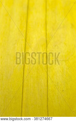 This Is A Photograph Of Yellow Wooden Popsicle Sticks Background