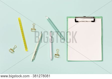 Flat Lay With Mock-up Notebook And Stationery For School Or Office. Blue And White Colored Pens, Rul