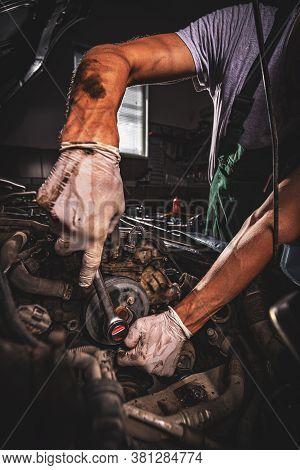 Auto Mechanic Working In Garage. Repair Service Concept