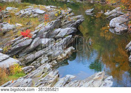 Rock formations by scenic Ottauquechee river near Woodstock, Vermont