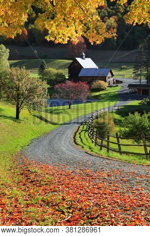 Scenic rural Vermont landscape in autumn time with old barn
