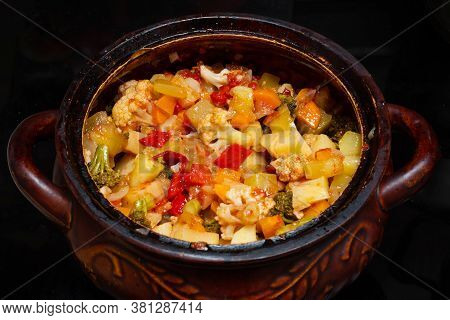 Close-up Of A Vegetable Stew In A Pot. Finely Chopped Various Vegetables Stewed In A Saucepan. Healt