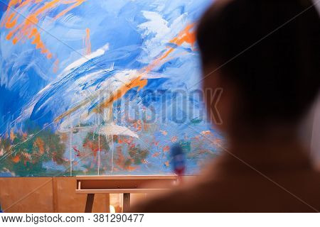 Looking At Colorful Large Painting In Art Workshop. Modern Artwork Paint On Canvas, Creative, Contem