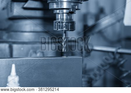 The Nc Milling Machine Making The Thread  At The Metal Plate By Tapping Tool.the Shop Floor Operatio