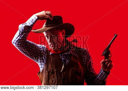 Portrait Of Farmer Or Cowboy In Hat. American Farmer. Portrait Of Man Wearing Cowboy Hat, Gun. Portr