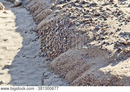 Close-up Of An Old Road In A Rural Area, A Road Made Of Sand Without Asphalt Or Other Type Of Surfac