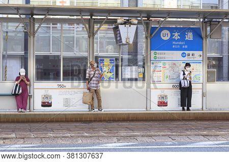August 5, 2020, Hiroshima, Japan - People Wait For A Hiroshima Streetcar (hiroden) At Hondori Statio