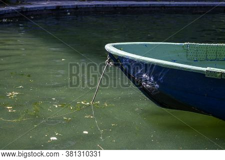 The Bow Of A Blue Wooden Boat On A Pond. Sun Glare On Board The Boat. Moscow, Patriarch's Ponds, Rus