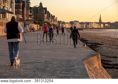 St Malo, France - September 16, 2018: People Walking Along Promenade At Seafront In Saint Malo, Brit