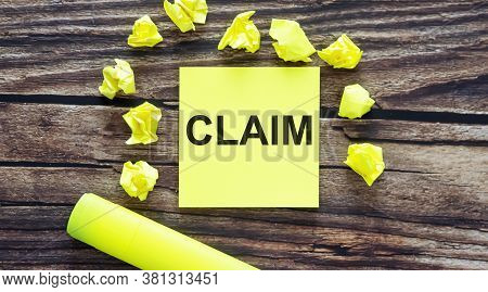 Claim. Notes About Claim ,concept On Yellow Stickers On Wooden Background