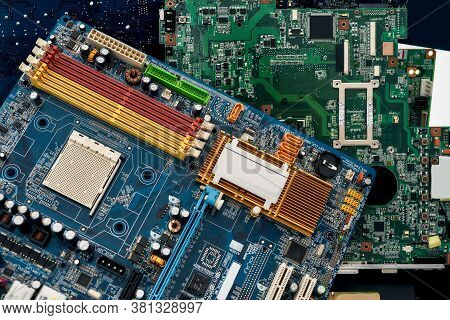Close Up Of Colored Heap Of Electronic, Plastic And Metal Parts From Old Discarded Or Obsolete Pc Co