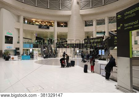Lisbon, Portugal - May 20, 2018: People Wait At Lisbon Portela International Airport In Portugal. Th