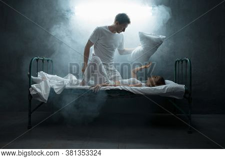 Psycho man strangles woman in bed, psychedelic